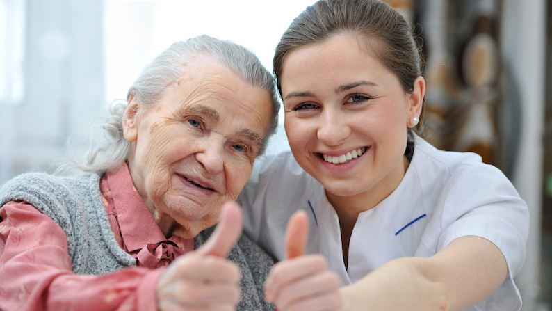 Alzheimer's Disease patient with help from medical staff